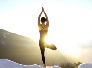 Yoga devant soleil